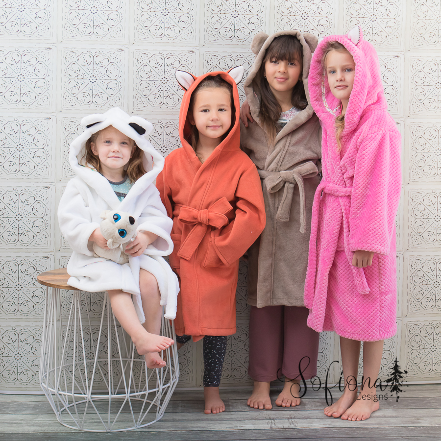 Arctic Fox housecoats with fox, bear, and rabbit ears. Mid and long length. Pockets. Made for warm fleece robes.