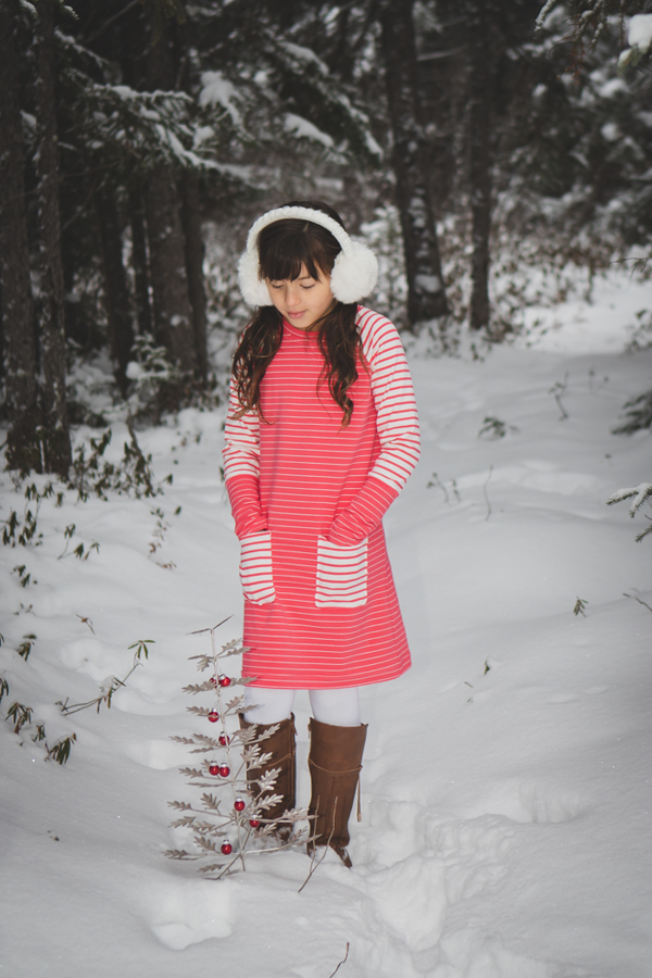Aurora dress length with long sleeves and long banded hem on the sleeves. Sweater dress for cold weather. Pockets are banded neckline.