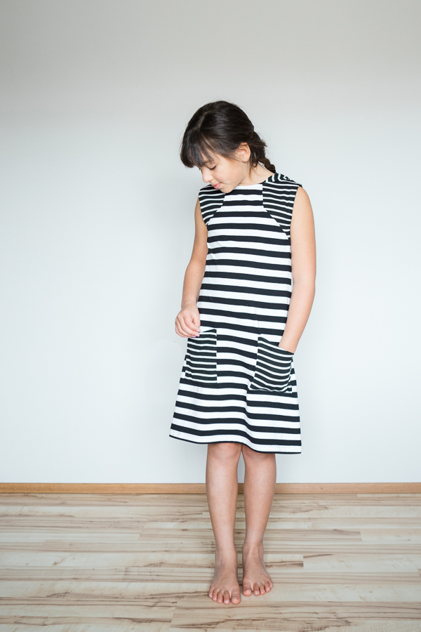 Moss knee length knit dress or swim cover with pockets and angled bodice detail.