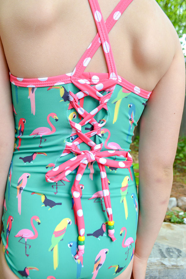 One piece Narwhal swimsuit with lace up back detail and beads.