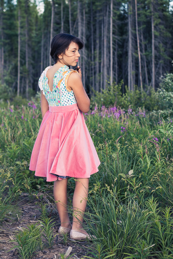 A special occasion Fireweed Dress with all flounces and a circle skirt. Invisible zipper back.