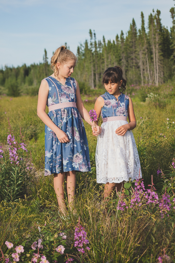 A pair of Fireweed dresses with gathered skirt. Optional flounces allow for different looks.