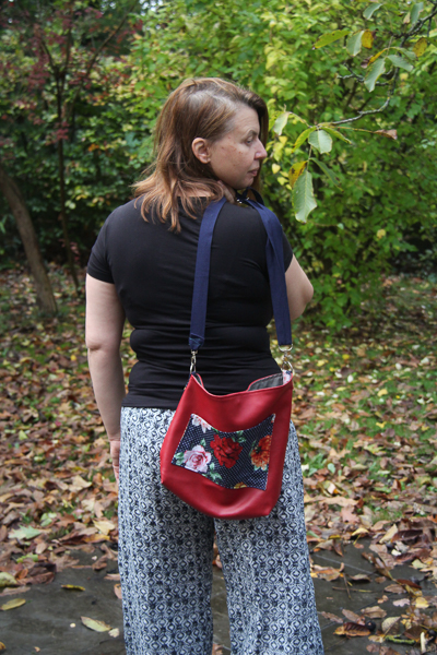 The Balsam Bag fundraising bag for A21. Envelope corners, angled top, cross body strap and front pocket.