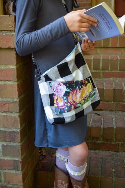 The Balsam Bag fundraising bag for A21. Envelope corners, angled top, cross body strap and front pocket. Perfect for teens, tweens, girls.