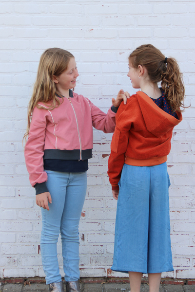 Two Rose Hip jackets. One with a hood and one with the bomber style neckband.