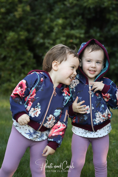 Cute Rose Hip jackets for these adorable twin girls. With piping and welt pockets and gusseted hoods.