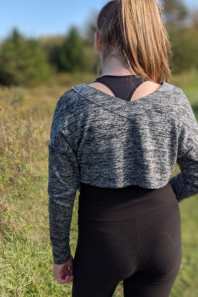The Miss Tundra top in crop length and long sleeves with visible neckline facing.