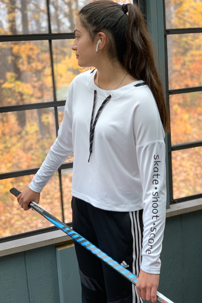 The Miss Tundra top in waist length and long sleeves with grommets on the neckline and vinyl lettering on the sleeve.