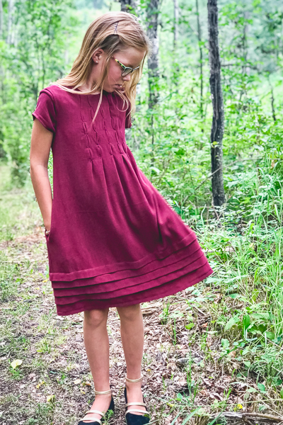 The Haze by Sofiona Designs for girls' sizes 2-16 in the dress length with bubble tuck bodice and pleated hem.