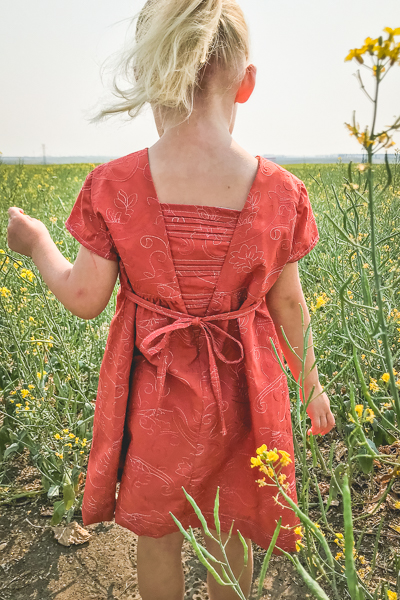 The Haze by Sofiona Designs for girls' sizes 2-16 in the dress length with simple hem and pleated V back.