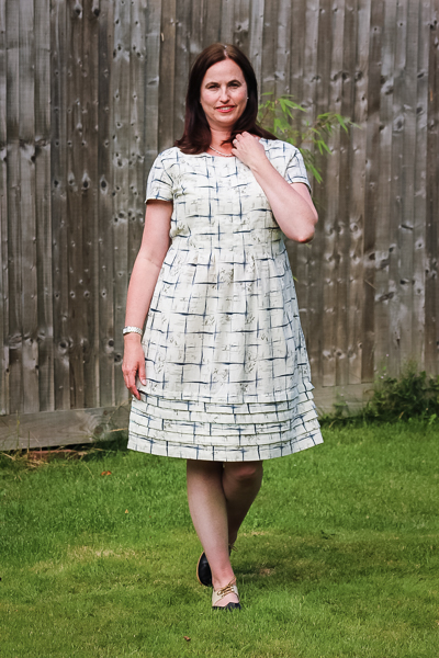 The Miss Haze dress with pleated bodice, pleated hem, and waist ties. Available from Sofiona Designs in junior miss sizes 0-20.