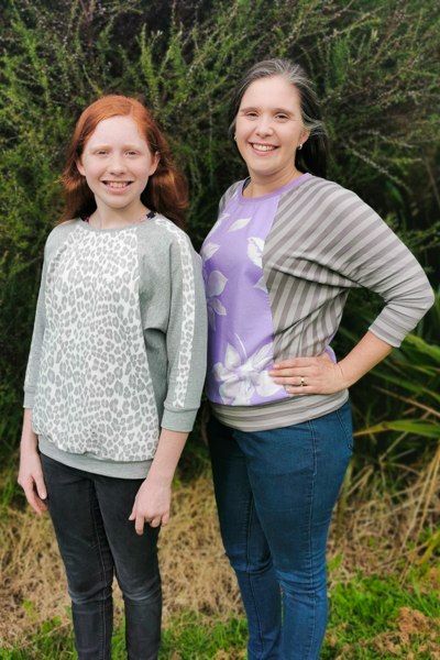 A hip length raglan sweater with batwing sleeves in 2 size ranges.