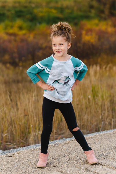 A raglan sweater with batwing sleeves with stripe details in girls' sizes 2-16. Excellent for custom panels.