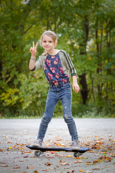 A raglan sweater with batwing sleeves and elastic waistband in girls' sizes 2-16.